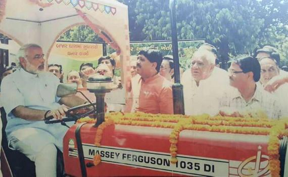 India's 14th Prime Minister Narendra Modi is seen on a MF tractor in an image from during his tenure as Gujarat's Chief Minister